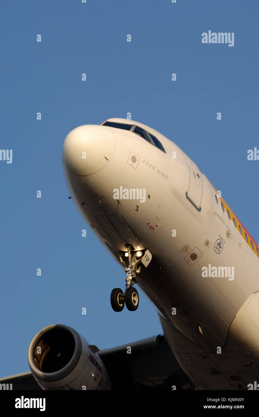 Iberia Airbus A320-200 with nosewheel undercarriage down for landing on final-approach - Stock Image