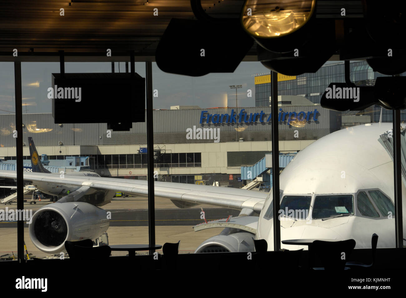 windshield of the South African Airways Airbus A340 parked at a gate and Lufthansa Boeing 737 parked behind at the Stock Photo