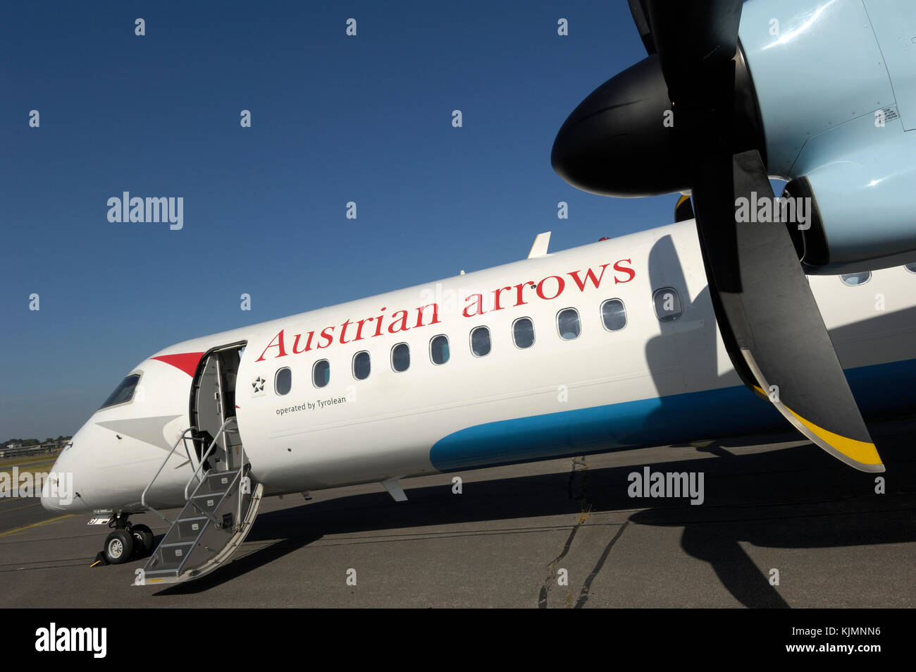 propellers and open door of the Austrian Arrows Bombardier DHC-8 Dash 8-400 Q400 parked in the static-display at - Stock Image