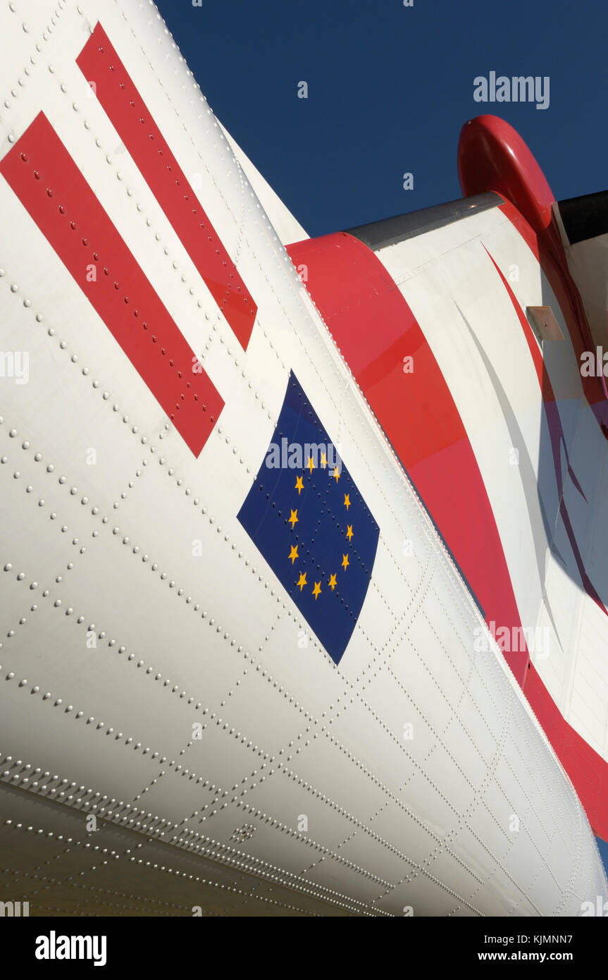 tail-fin of the Austrian Arrows Bombardier DHC-8 Dash 8-400 Q400 parked in the static-display at the 2006 Farnborough - Stock Image