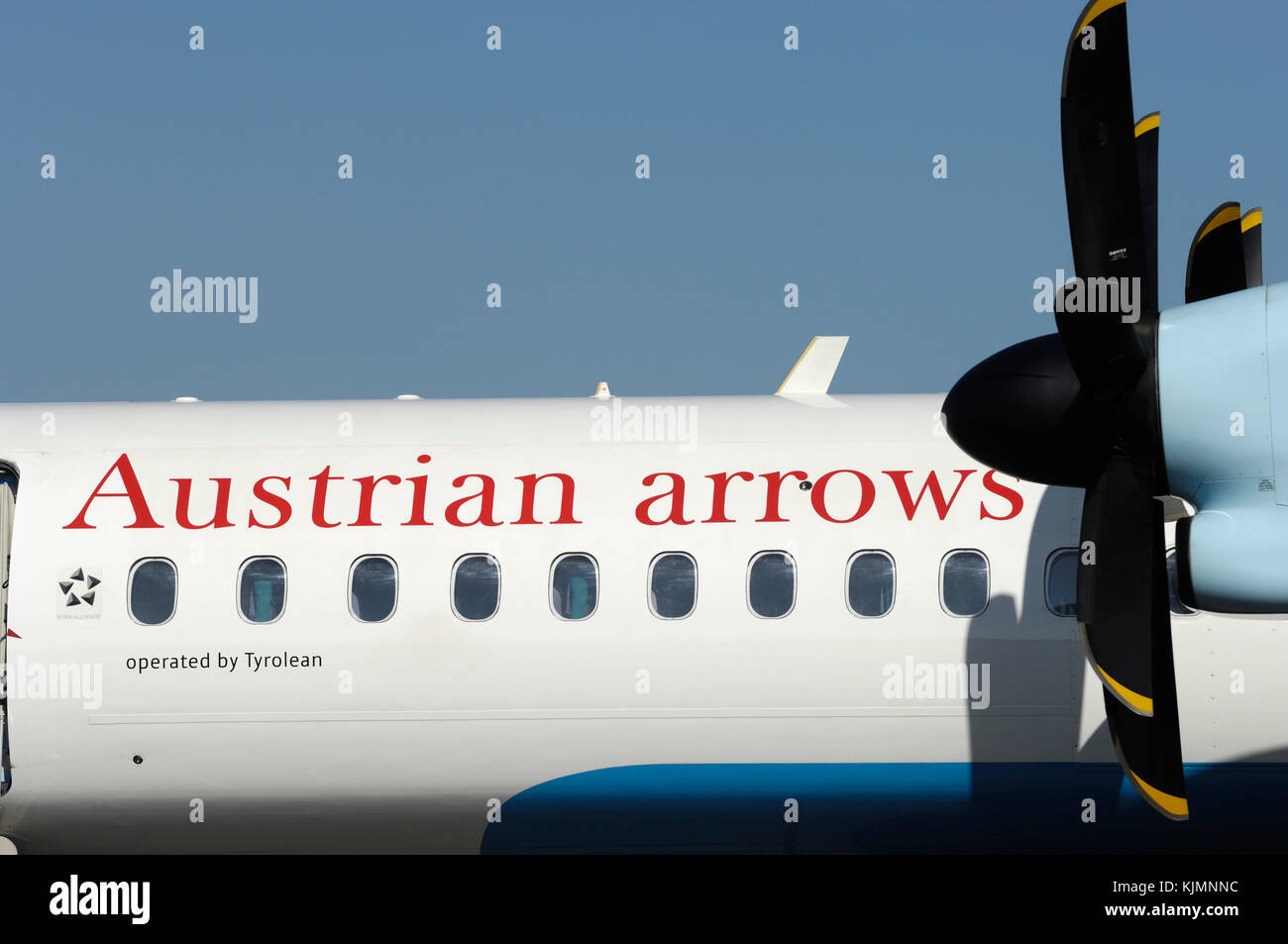 propellers and windows of the Austrian Arrows Bombardier DHC-8 Dash 8-400 Q400 at the 2006 Farnborough International - Stock Image