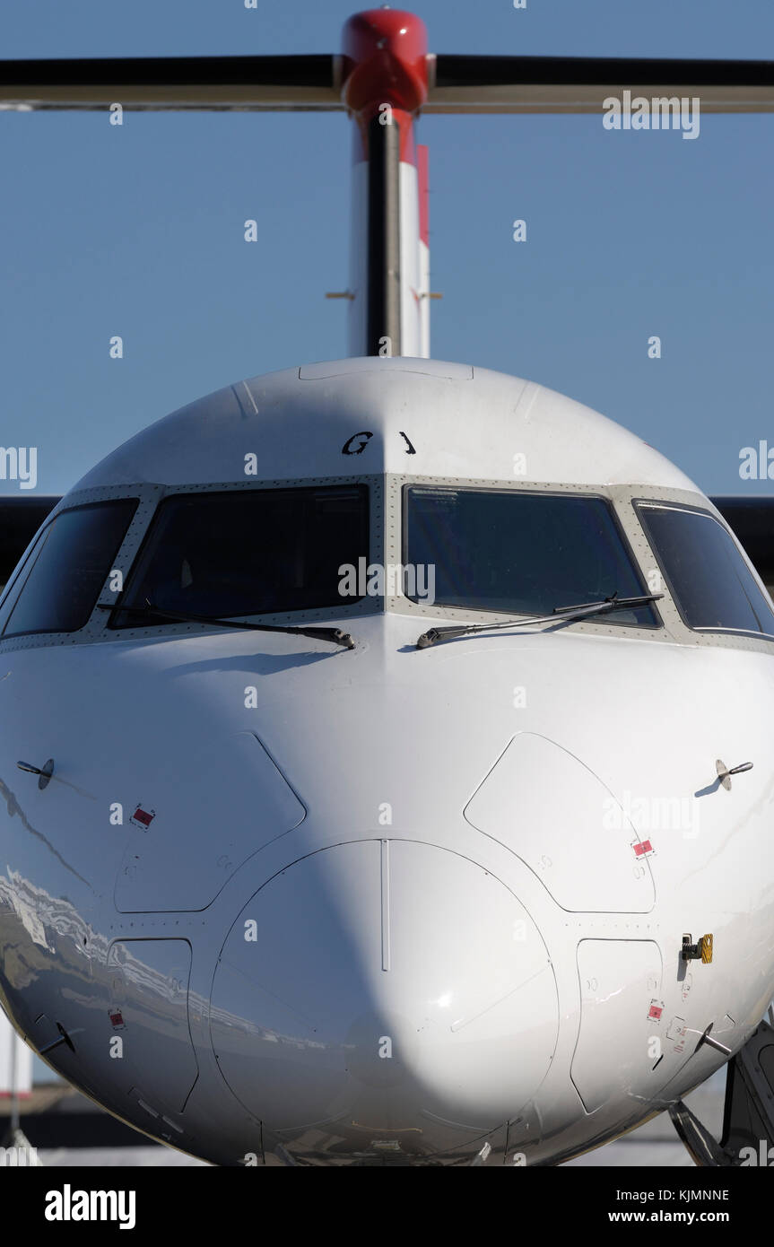 windshield and tail-fin of the Austrian Arrows Bombardier DHC-8 Dash 8-400 Q400 at the 2006 Farnborough International - Stock Image