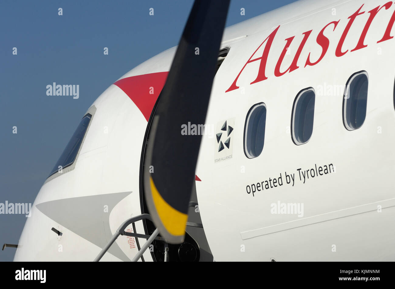 propellers, windows and windshield of the Austrian Arrows Bombardier DHC-8 Dash 8-400 Q400 at the 2006 Farnborough - Stock Image