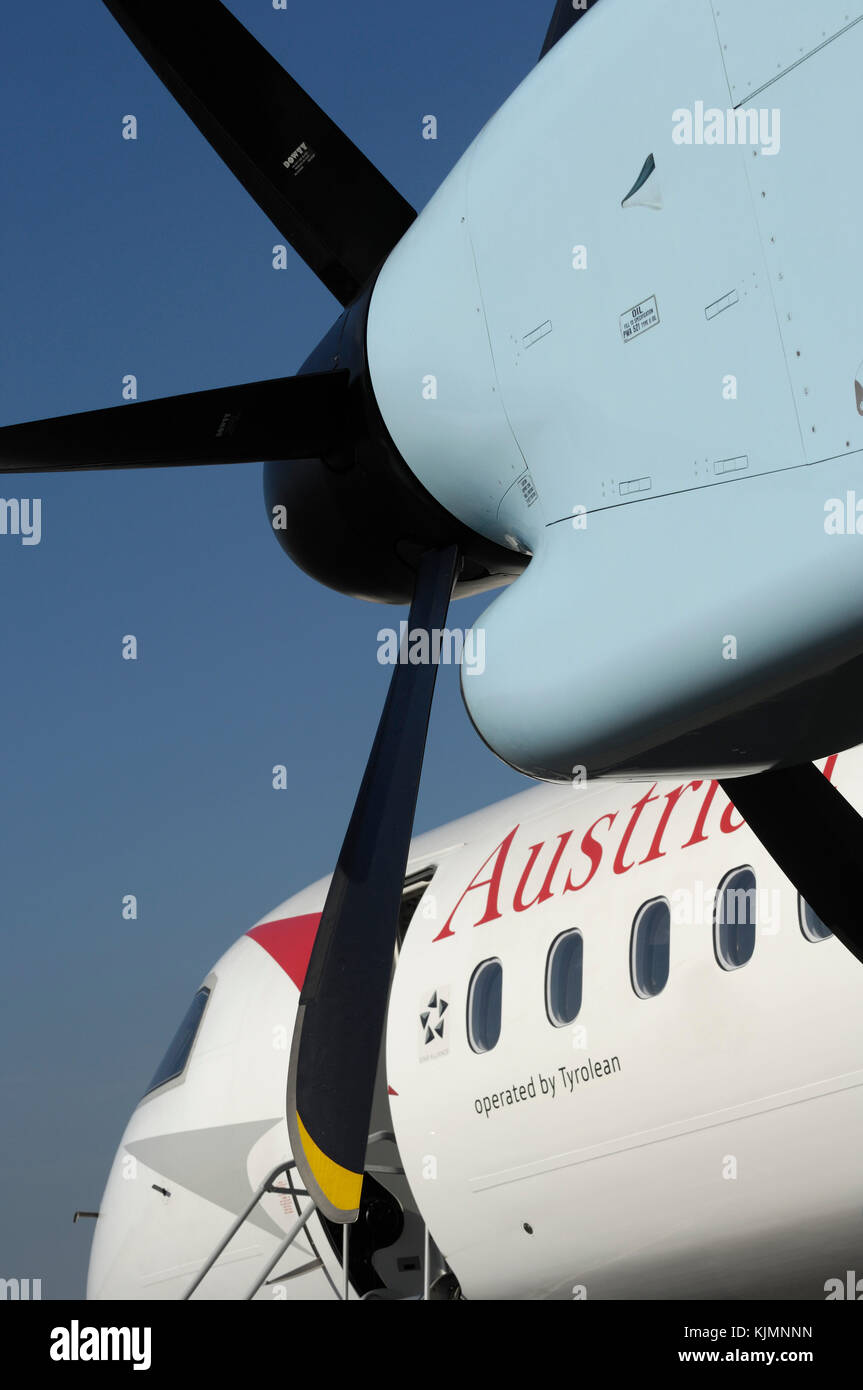 PW150A engine cowling, propellers, windows and windshield of the Austrian Arrows Bombardier DHC-8 Dash 8-400 Q400 - Stock Image
