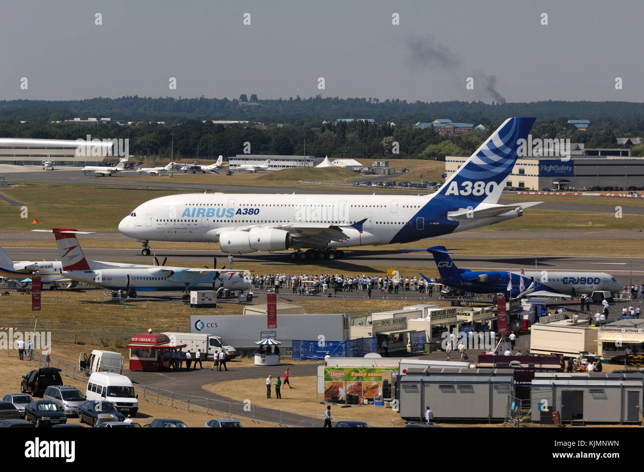 Airbus A380-800 taxiing with the Bombardier CRJ-900 and