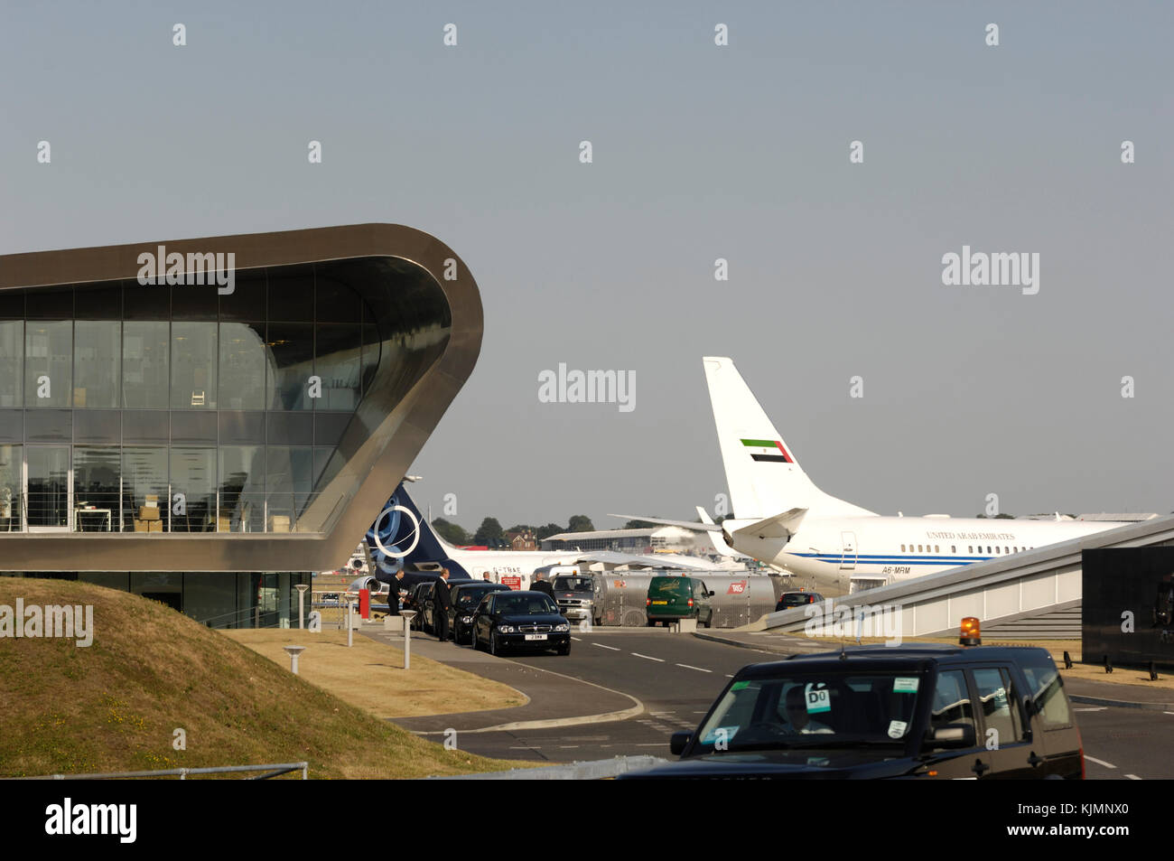 Amiri Flight Boeing 737-800 BBJ, BAE 146-300 and Bombardier Global Express parked, the TAG Aviation terminal and - Stock Image