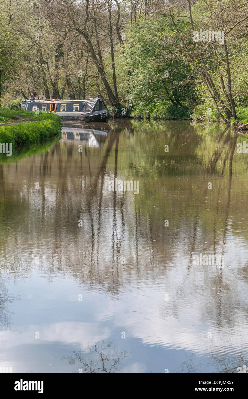 A narrowboat on the canalised section of the River Churnet in Staffordshire. - Stock Image