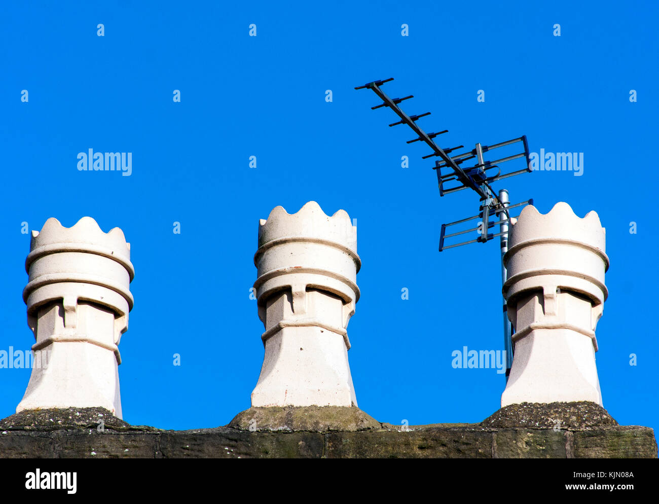 TV Aerial on Old Chimney Pots - Stock Image