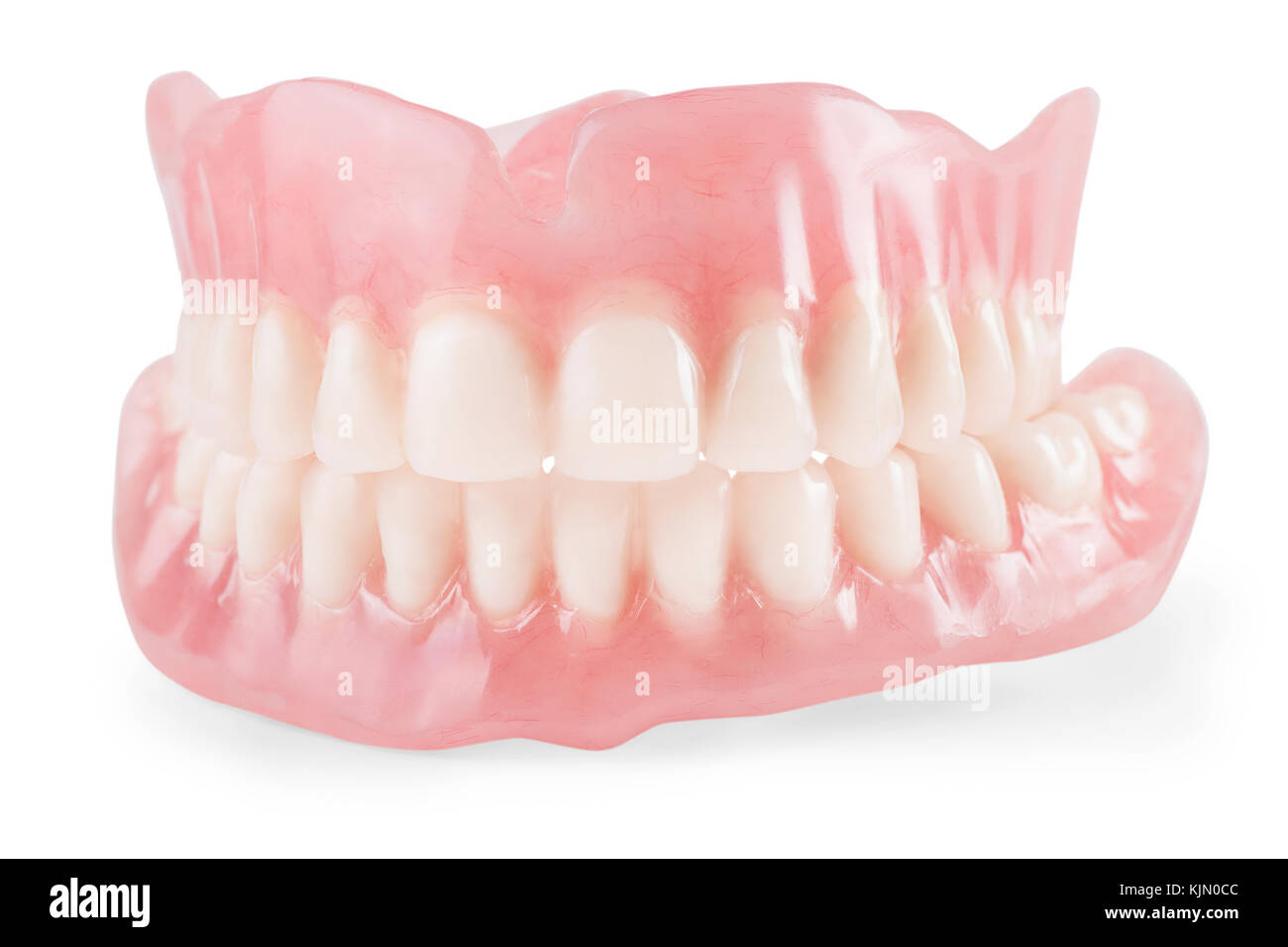 False teeth close up. Isolated on white, clipping path included - Stock Image