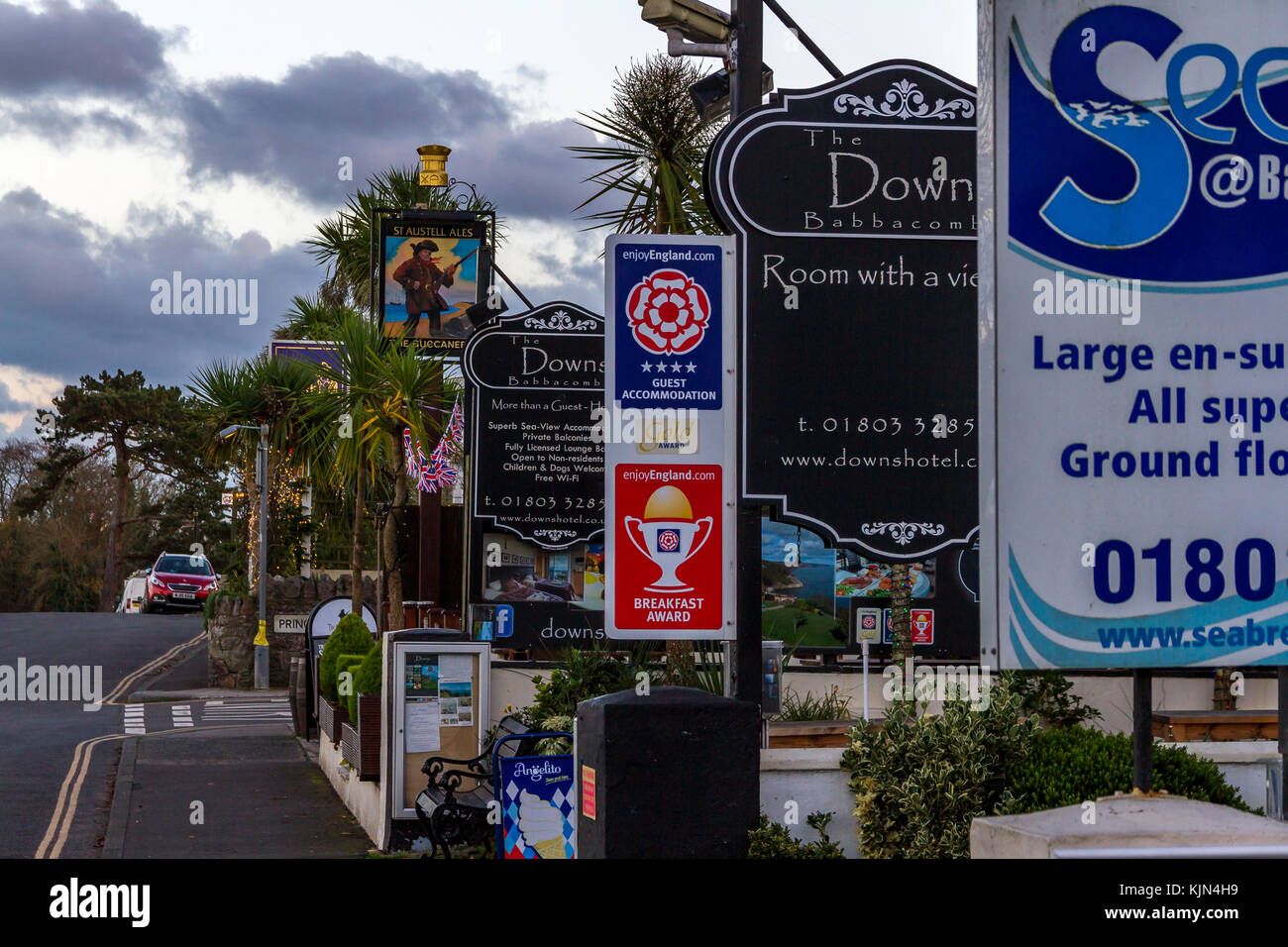 Signage for a row of accommodation and bars along Downs Road, in Babbacombe, Torquay, England, Devon, UK. November - Stock Image