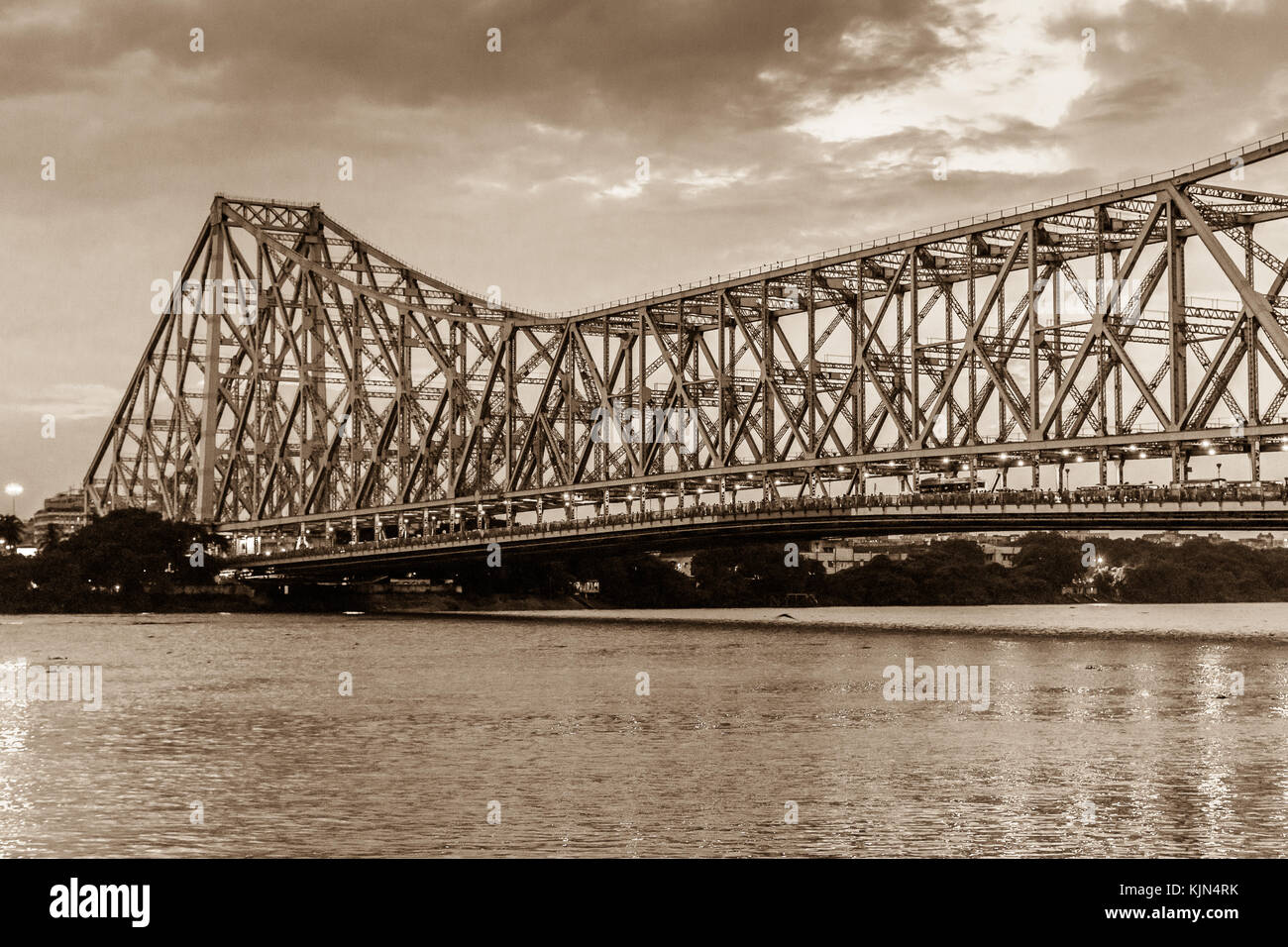 Howrah bridge in sepia color - The historic cantilever bridge on the river Hooghly with moody sky. - Stock Image