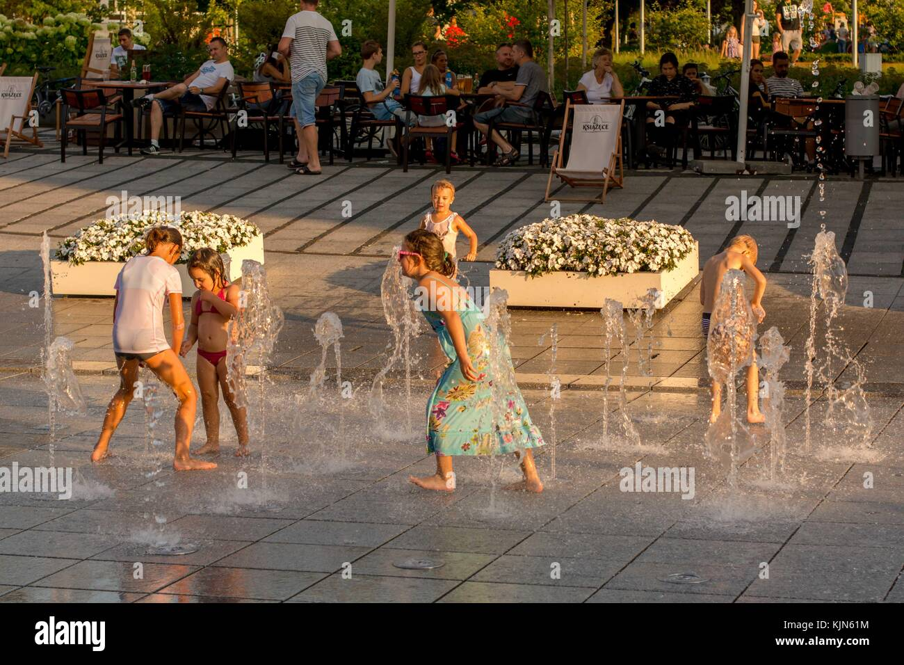 Fountain and children in John Paul 2 Square in Rybnik Poland - Stock Image