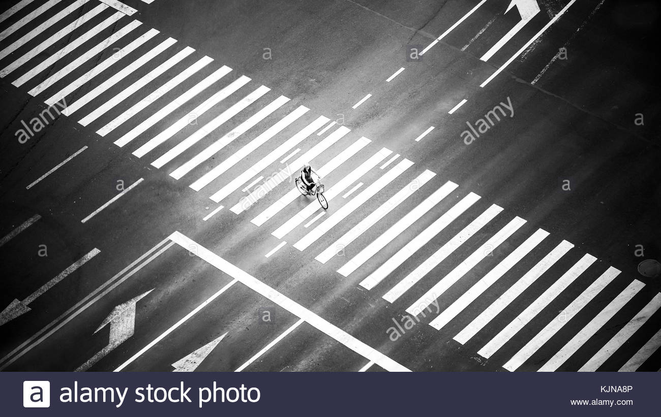 Passerby on zebra crossing - Stock Image