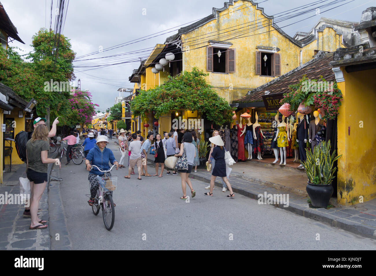 Hoi An, Vietnam - June 2017: busy shopping street with boutiques in Hoi An Vietnam - Stock Image