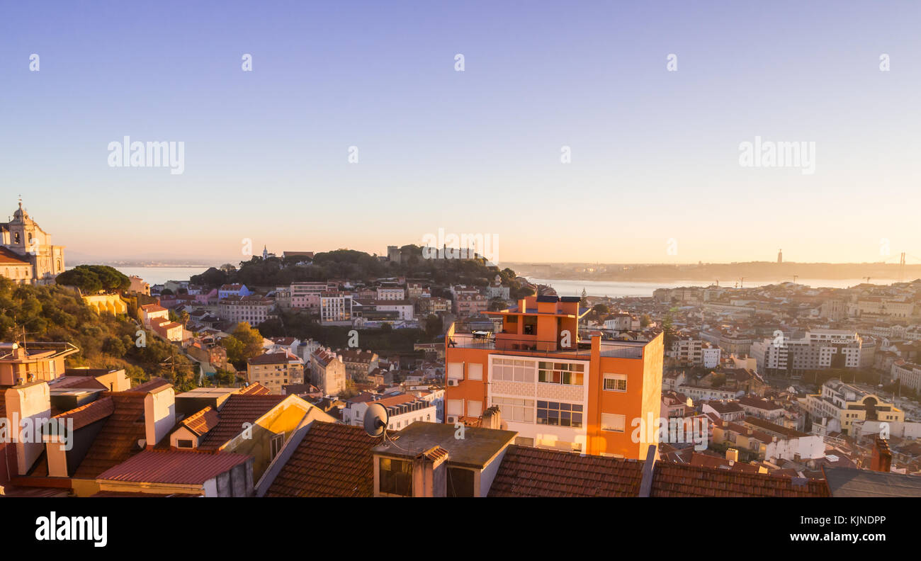 Cityscape of Lisbon, Portugal, at sunset on a November day, as seen from Belvedere of Our Lady of the Hill wiev - Stock Image