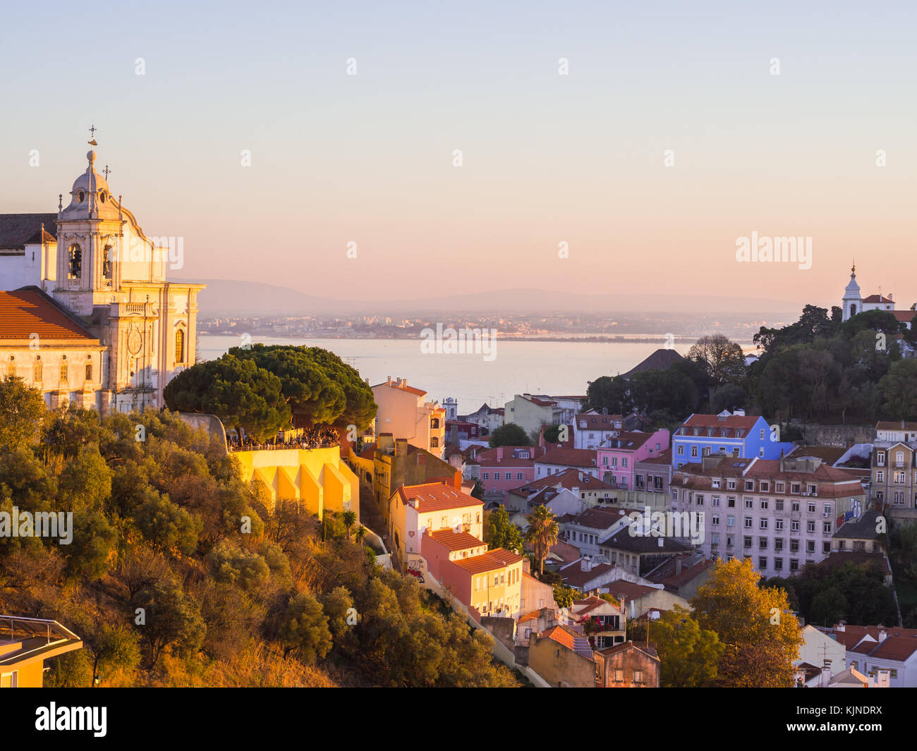 Cityscape of Lisbon, Portugal, with Igreja de convento da Graca, at sunset on a November day, Stock Photo