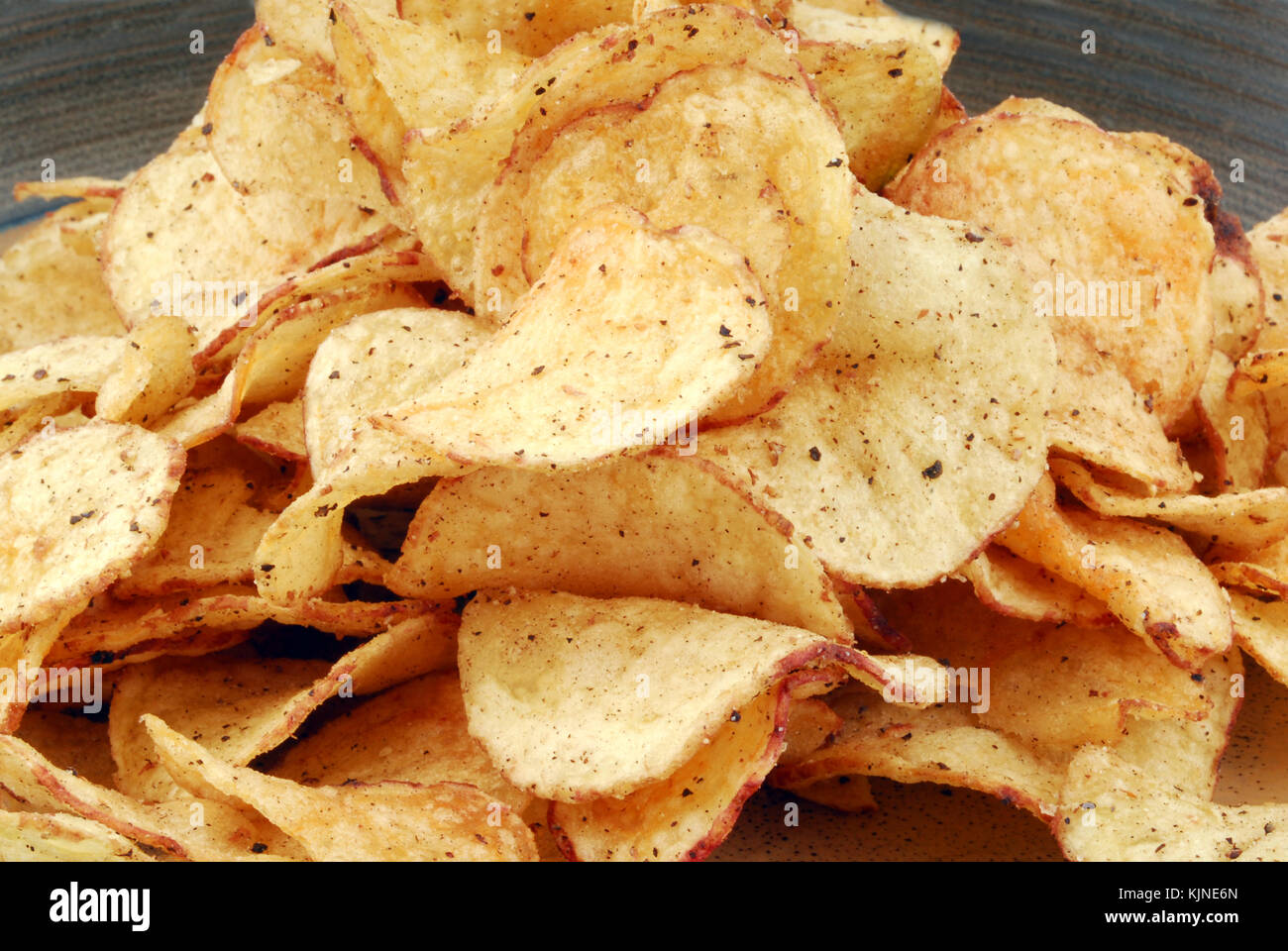 chips crisps on plate - Stock Image