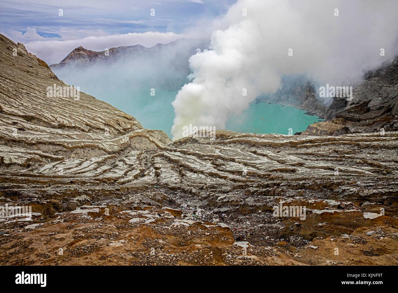 Sulfuric lake of Kawah Ijen Mountain's cauldron in the Banyuwangi Regency of East Java, Indonesia - Stock Image