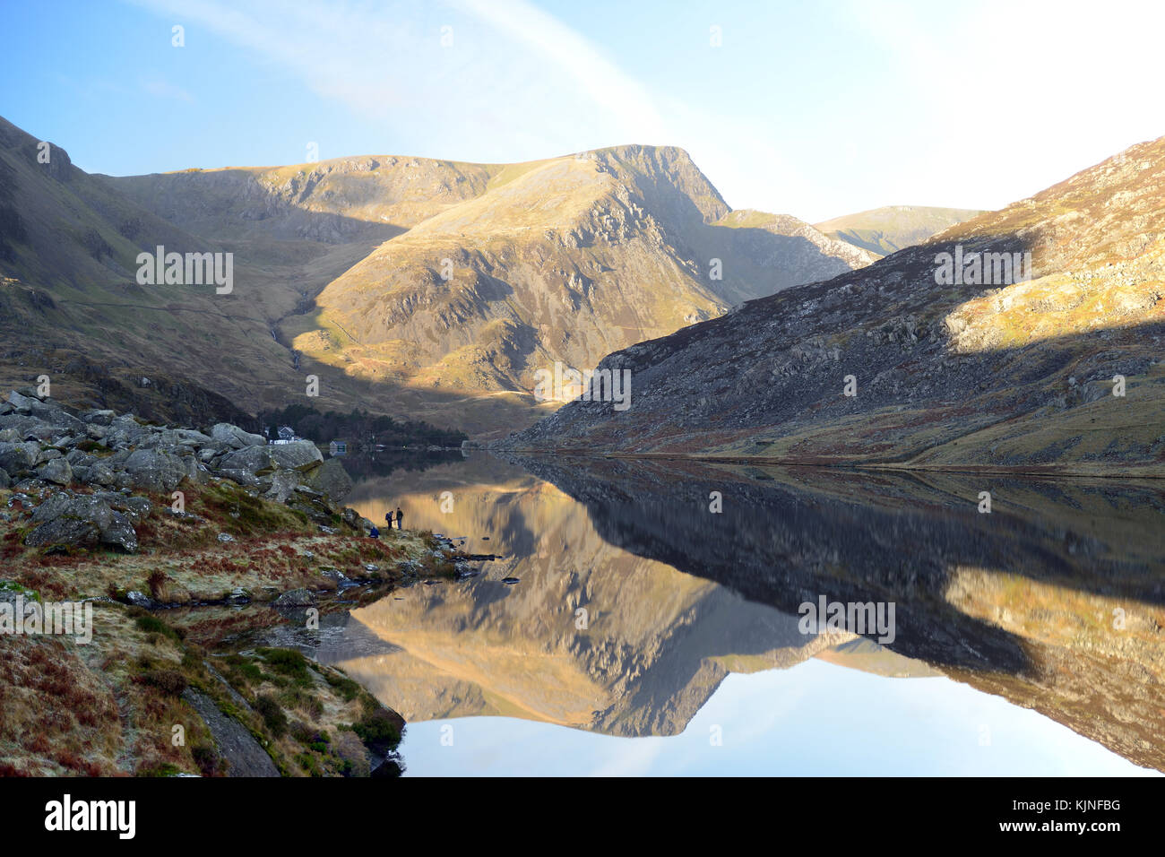 Lake Ogwen is located in Snowdonia between the Carneddau and the Glyderau mountain ranges. It is a visually stunning Stock Photo