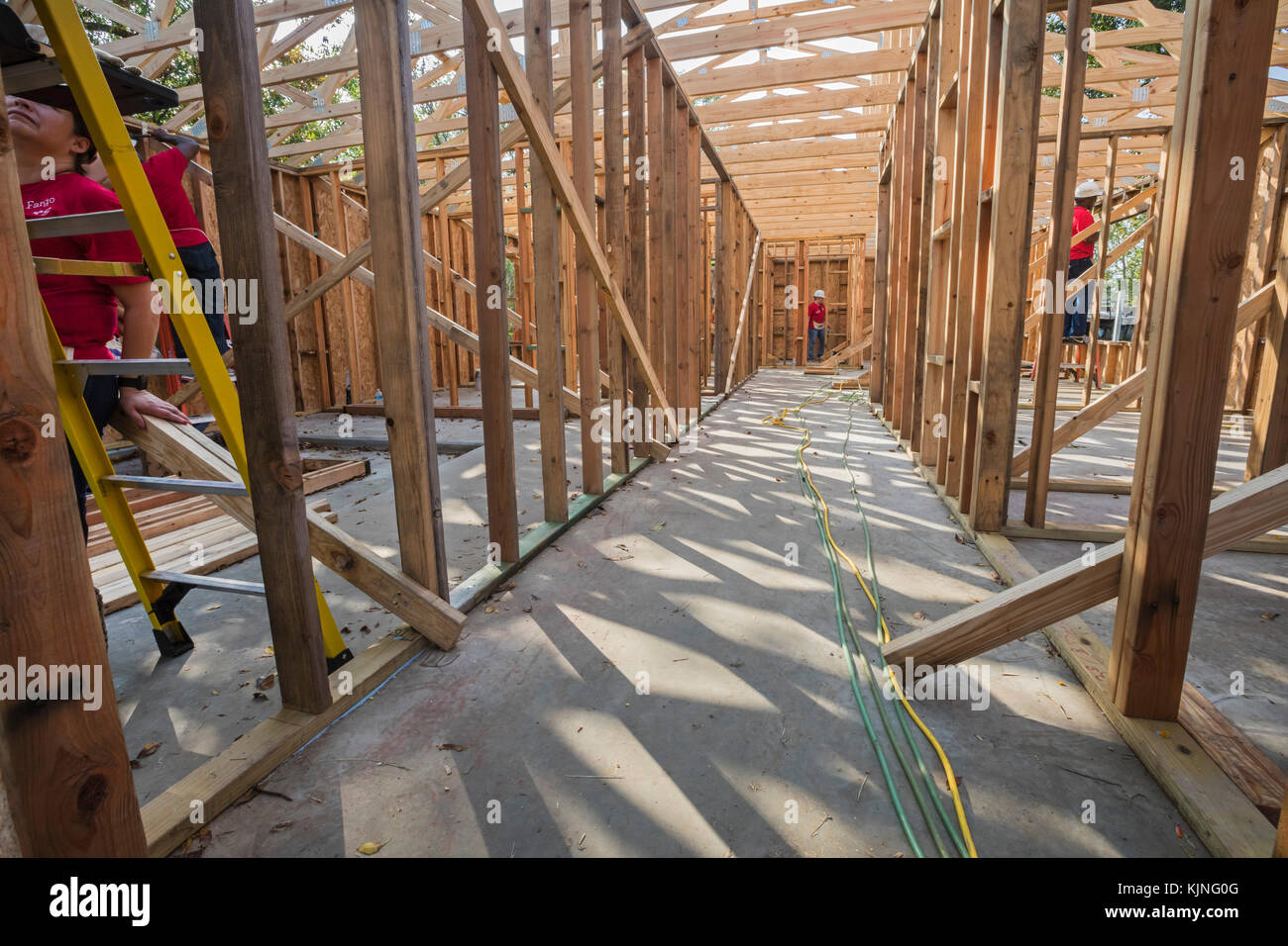 Houston, Texas - Volunteers from Wells Fargo Bank help build a Habitat for Humanity house for a low-income family. Stock Photo