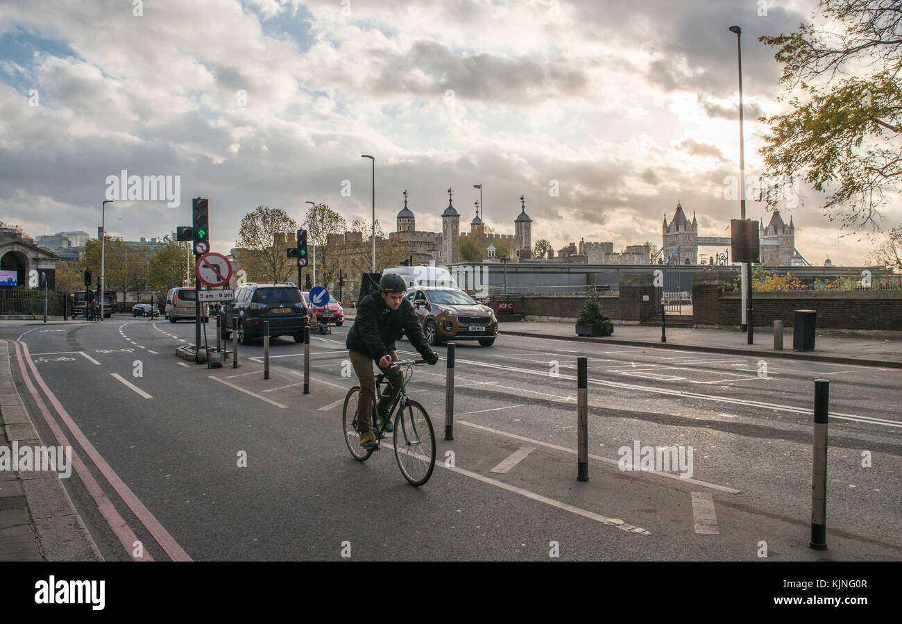 Cyclist on segregated cycling lane near Tower Hill in the City of London, UK - Stock Image