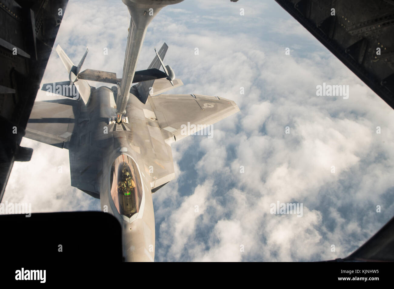 United States Air Force F-22 Raptor receives fuel from a KC-10 Extender over Syria, during a mission in support - Stock Image