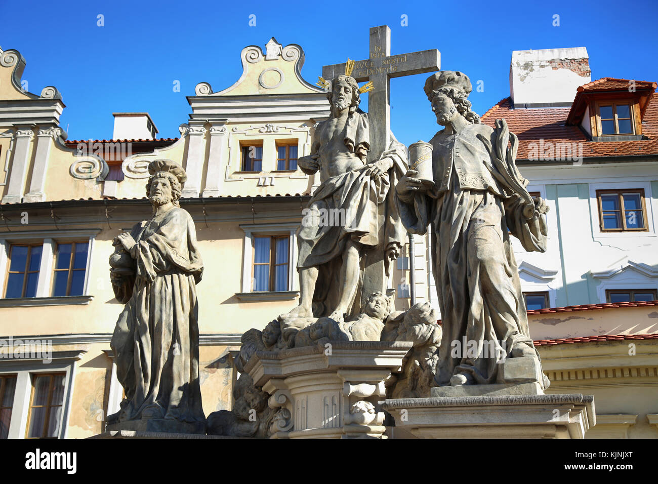 Statuary of Christ the Saviour with St. Cosmas and St. Damian on the Charles Bridge (Karluv Most) in Prague, Czech - Stock Image
