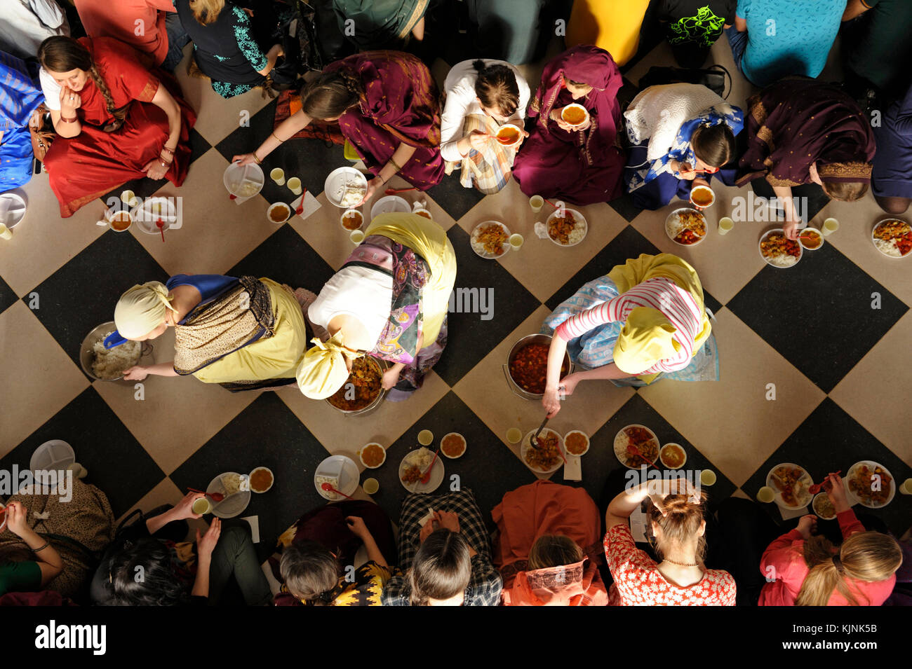 Attendants give to parishioners Prasad - food that is a religious offering in Krishnaism. April 3, 2017. The Krishna - Stock Image