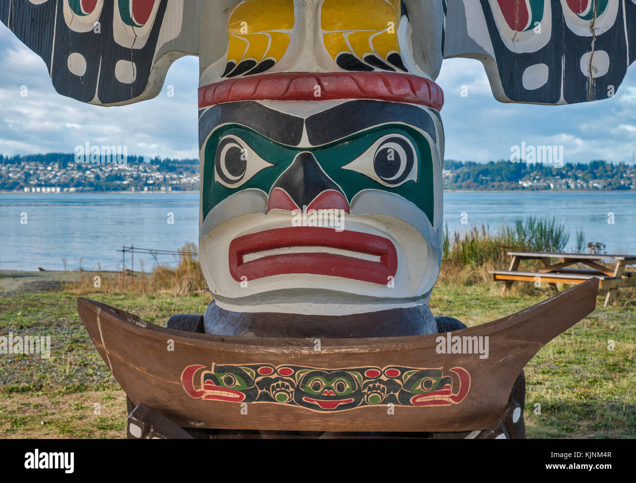 Figure of Wise Man at totem pole at shelter near Nuyumbalees Cultural Centre, We Wai Kai Nation in Cape Mudge village, - Stock Image