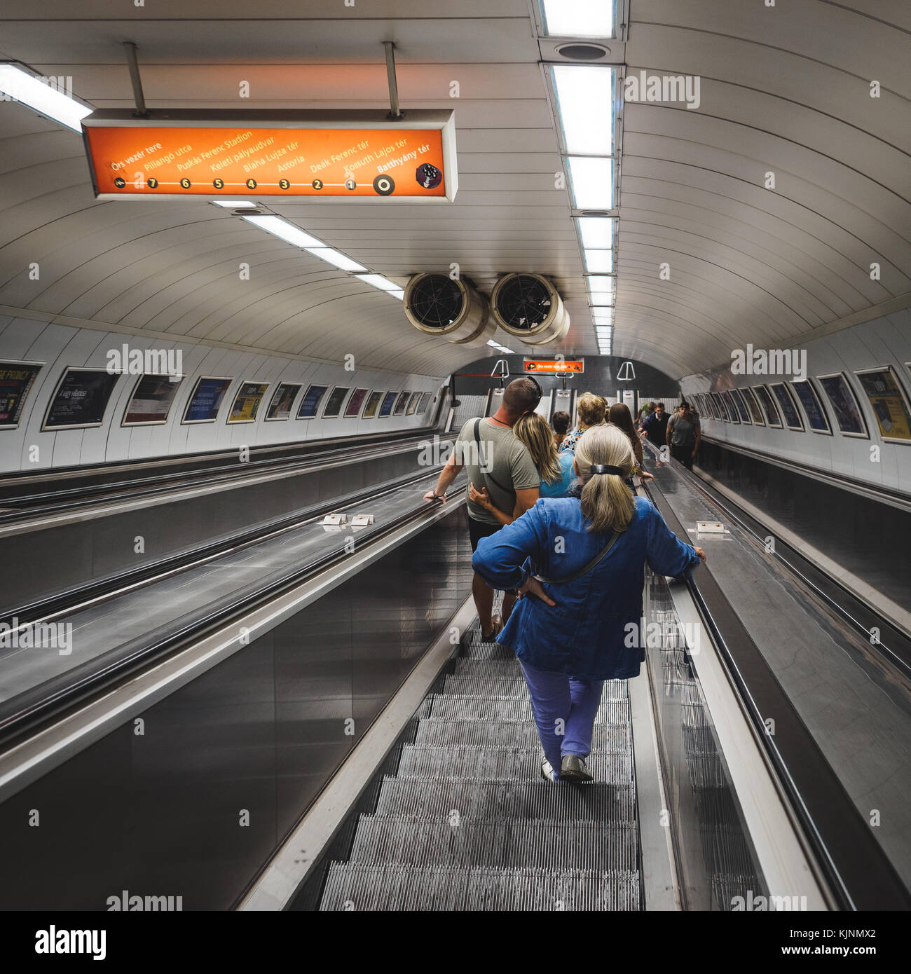 Underground transport users on the escalators in the Metro in Budapest (Hungary). June 2017. Square format. Stock Photo