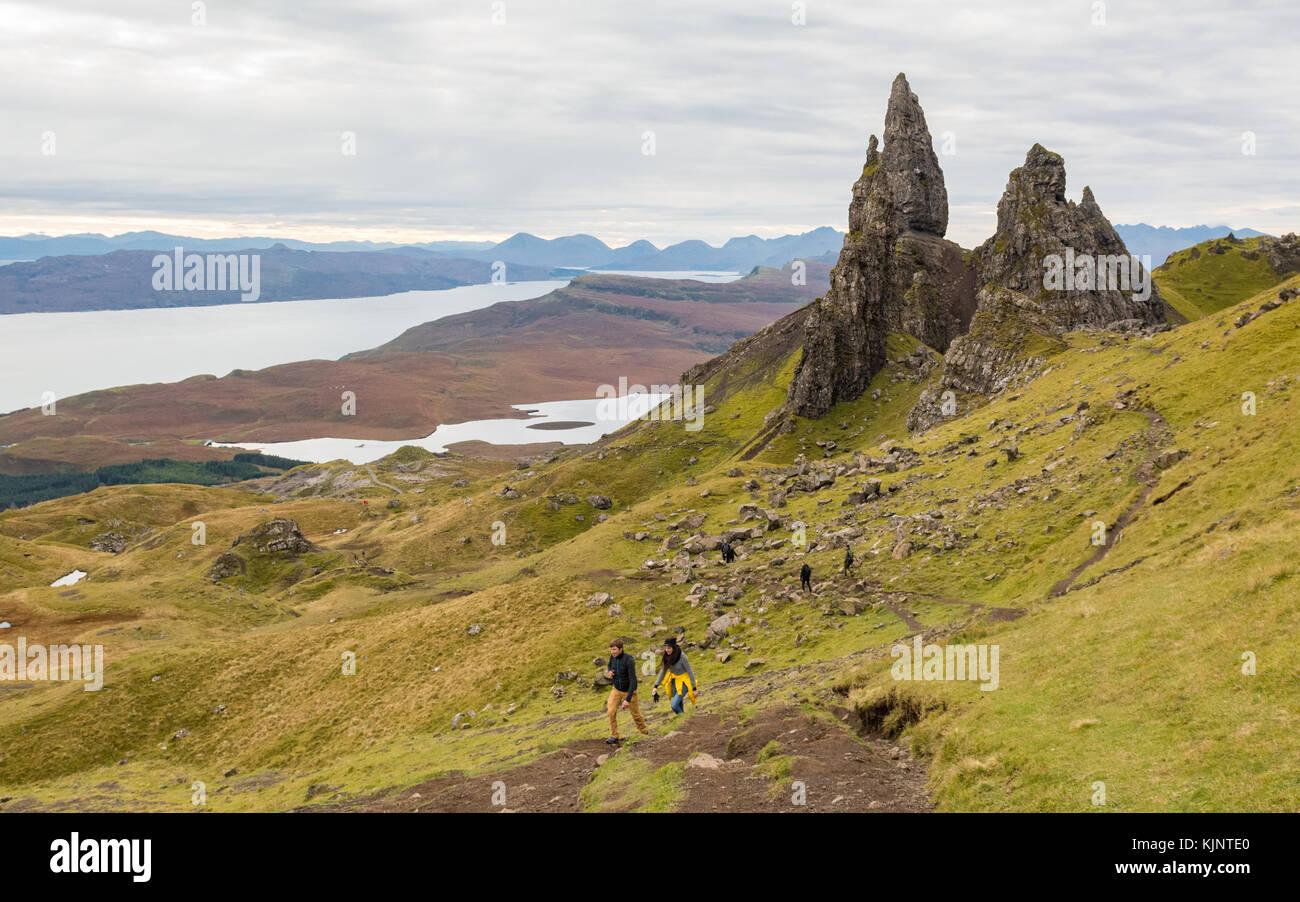 tourists walking at The Old Man of Storr, Isle of Skye, Scotland, UK - Stock Image