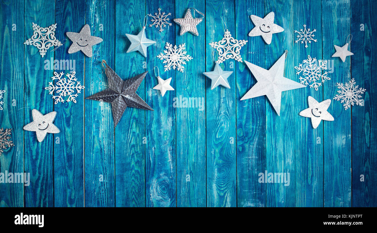 Christmas stars on wooden planks - Stock Image