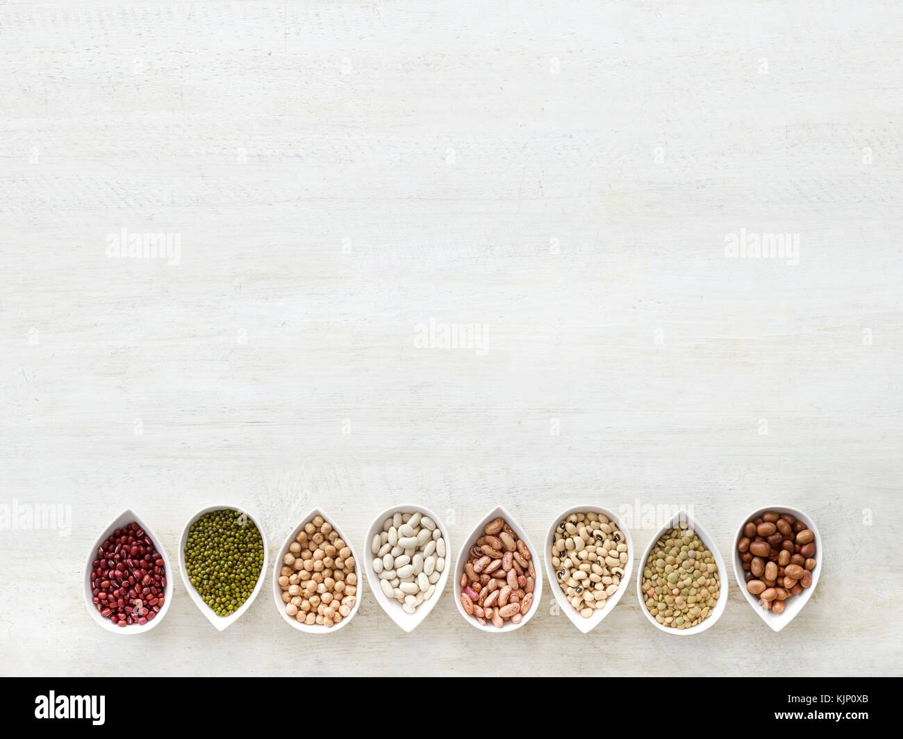 Pulses in tear shaped mini bowls, overhead view. - Stock Image
