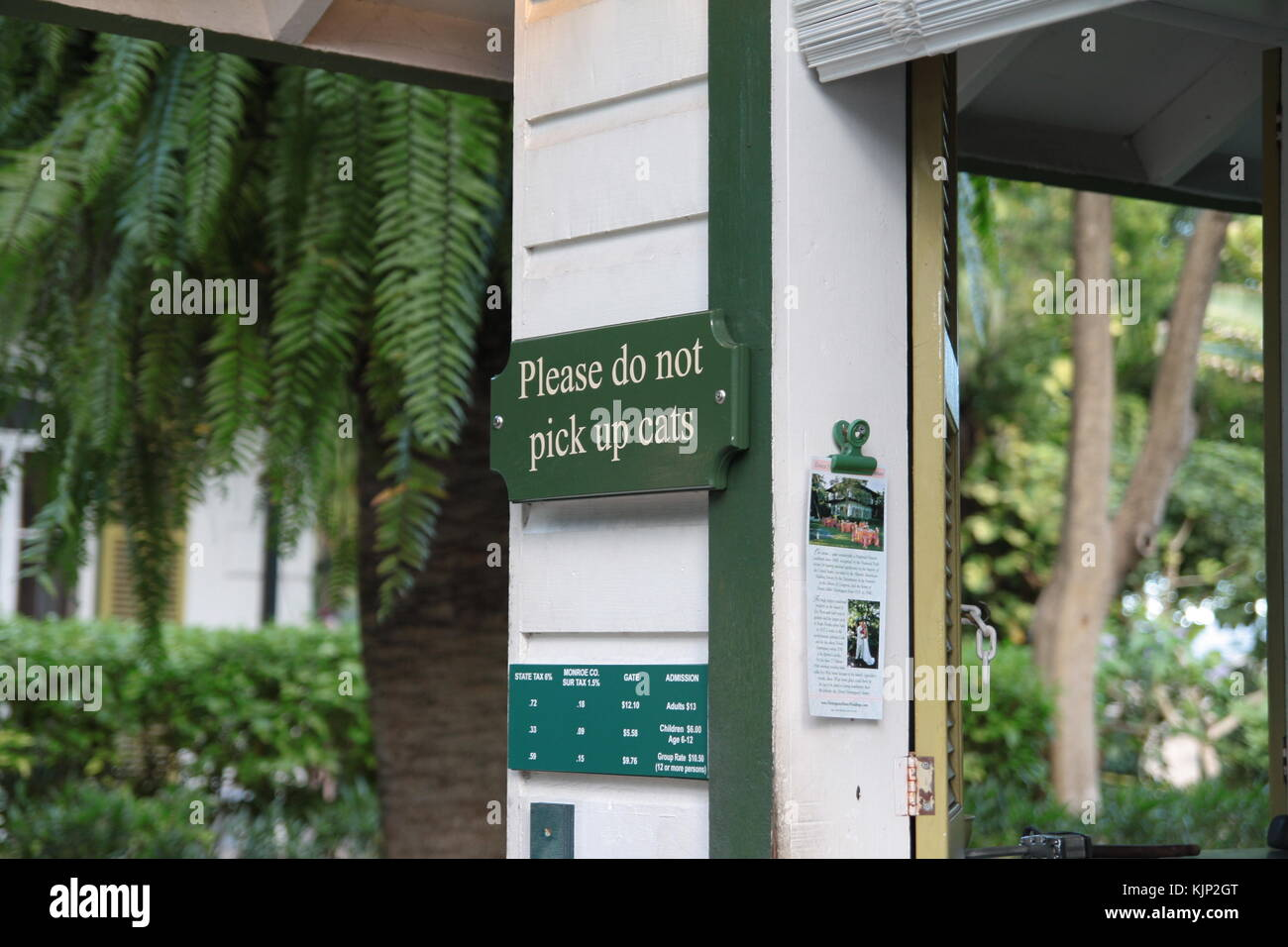 A signboard asks not to pick up cats at Ernest Hemingway house in Key West, Florida. Stock Photo