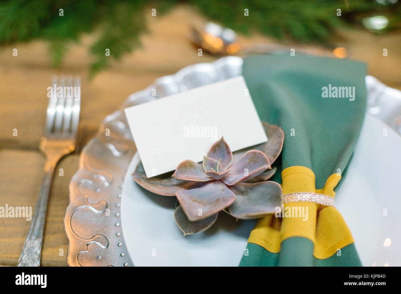 restaurant, dining, poligraphy concept. in the plate with white center and wavy silver glowing edge there is green - Stock Image