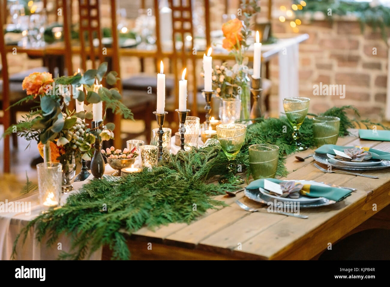 wedding, floral design, treat concept. amazing decor of restaurant table for lovers, on corners of it there are - Stock Image