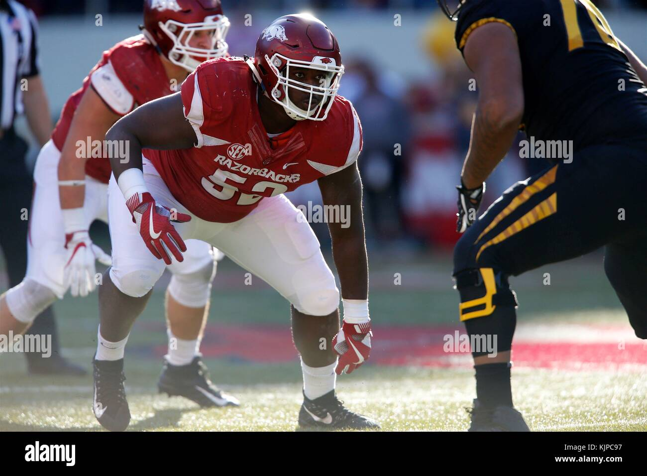 Nov 24, 2017: T.J. Smith #52 Arkansas defensive end comes out of his stance up the field. The Missouri Tigers defeated - Stock Image