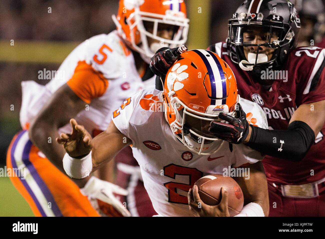 Columbia, SC, USA. 25th Nov, 2017. Clemson quarterback Kelly Bryant (2) gets dragged out by South Carolina defensive - Stock Image