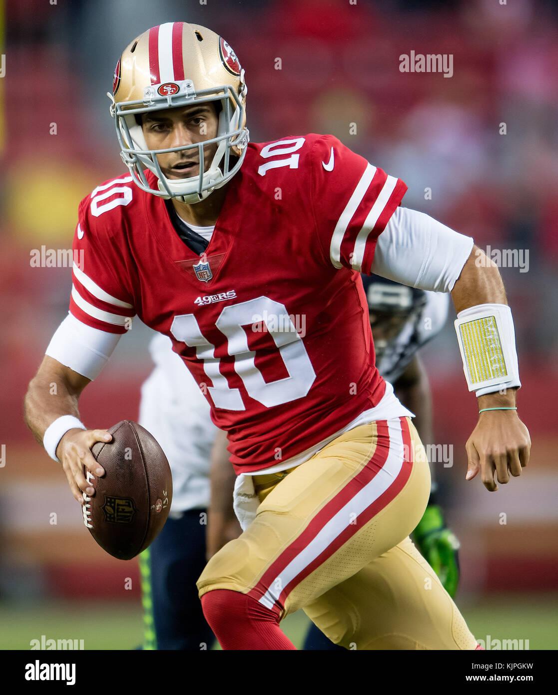 Santa Clara, California, USA. 26th Nov, 2017. San Francisco 49ers quarterback Jimmy Garoppolo (10) scrambles in - Stock Image