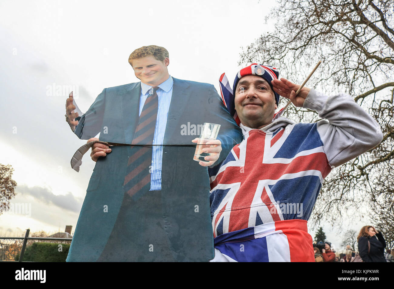 London, UK. 27th Nov, 2017. Royal well-wisher John Loughrey outside Kensington Palace with a cardboard cutout of Stock Photo