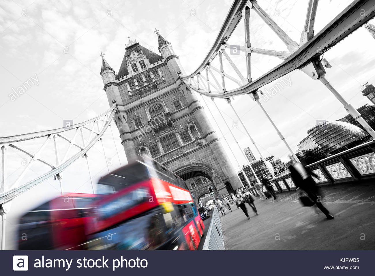 London Tower Bridge in a tilted angled, with two busses crossing. - Stock Image