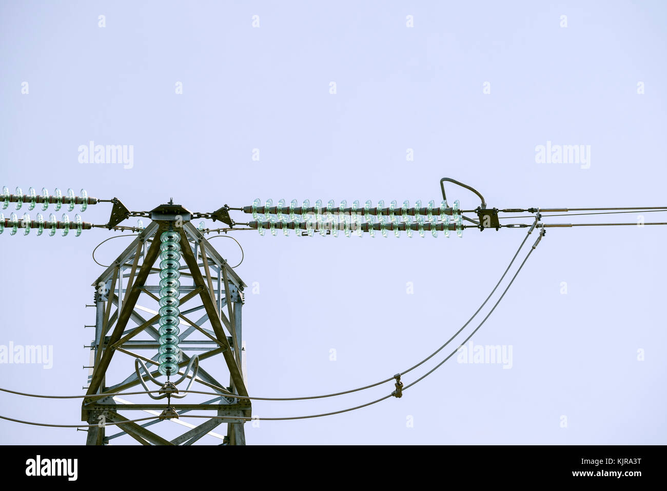 A detailed view of insulators on a high tension power line. - Stock Image