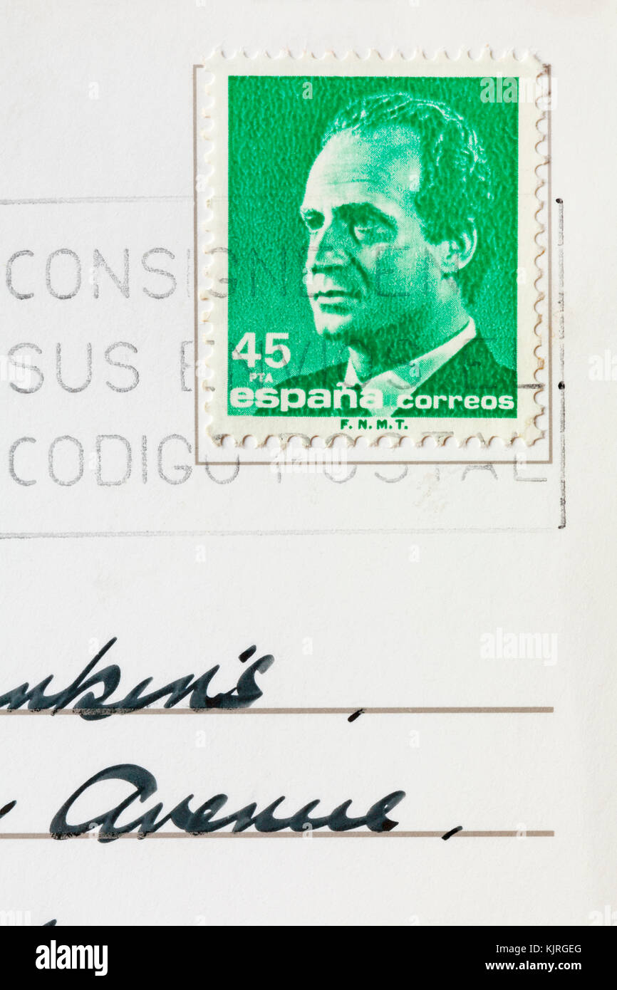 Spanish stamp stuck on postcard - Stock Image