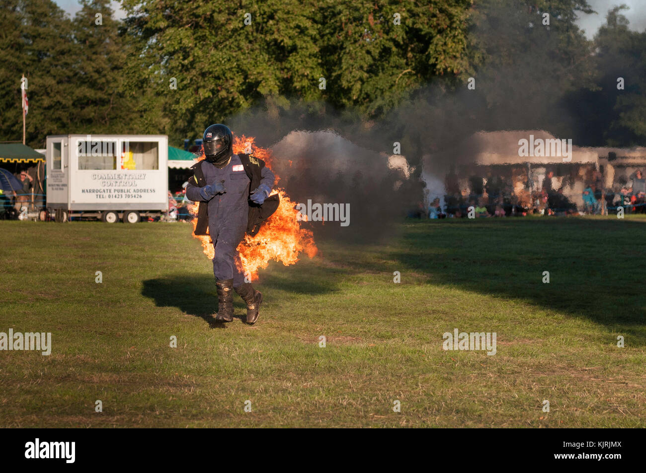 Astle Park, Cheshire, UK - August 12 2017: A stuntman on fire at Astle Park Traction Engine Rally - Stock Image