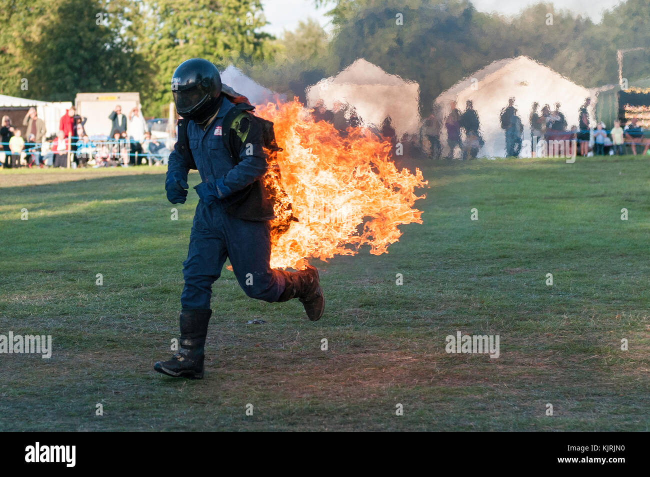 Astle Park, Cheshire, UK - August 12 2017: A stuntman on fire at Astle Park Traction Engine Rally Stock Photo