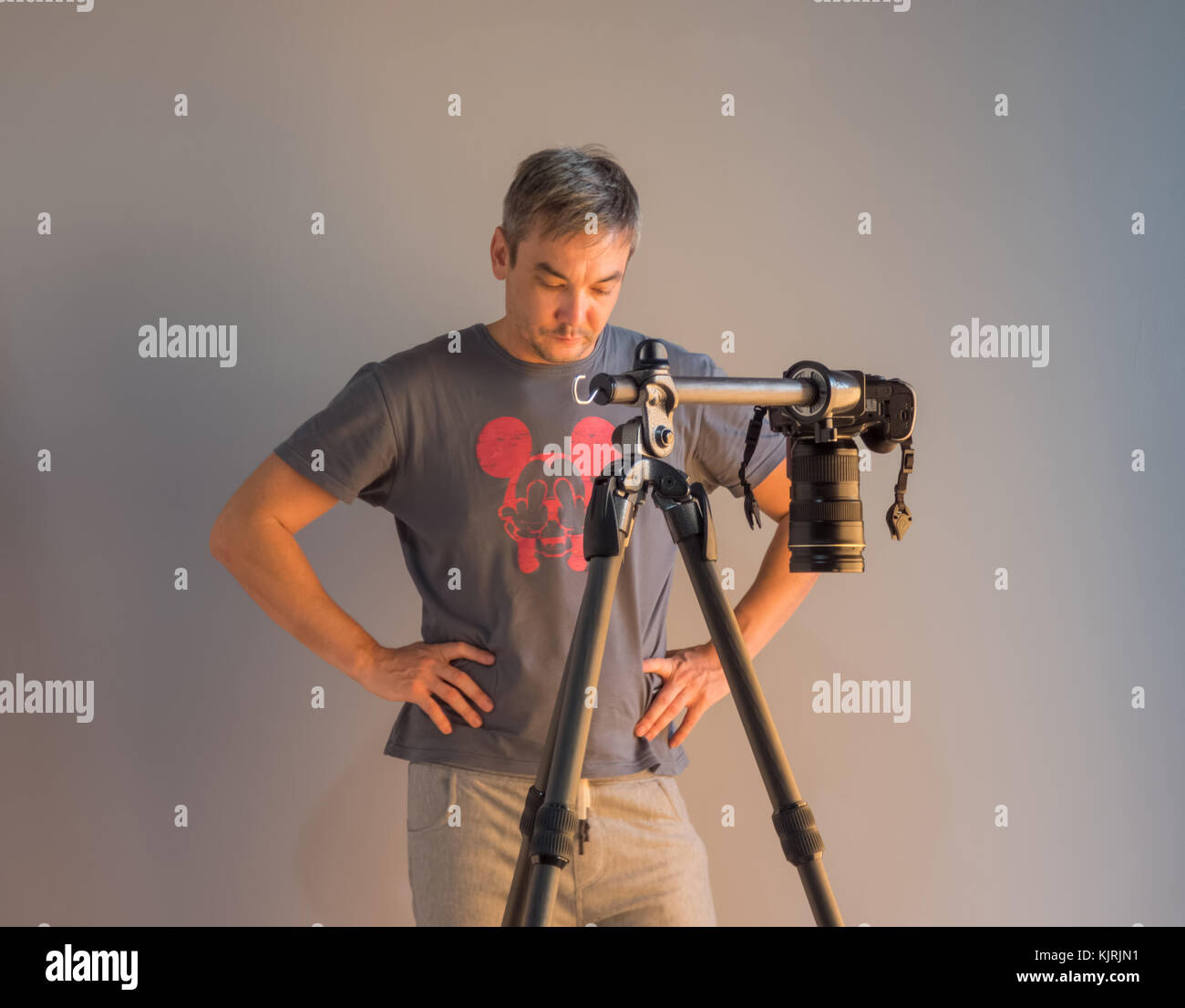 photographer in the process of working in the studio. unintended photography Stock Photo