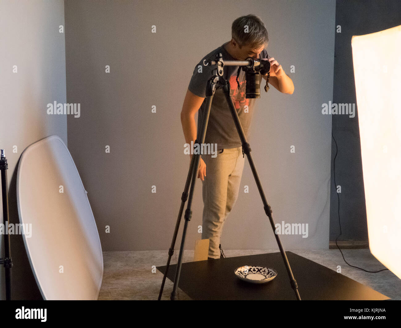 the photographer fills the order in the studio. unintended photography Stock Photo