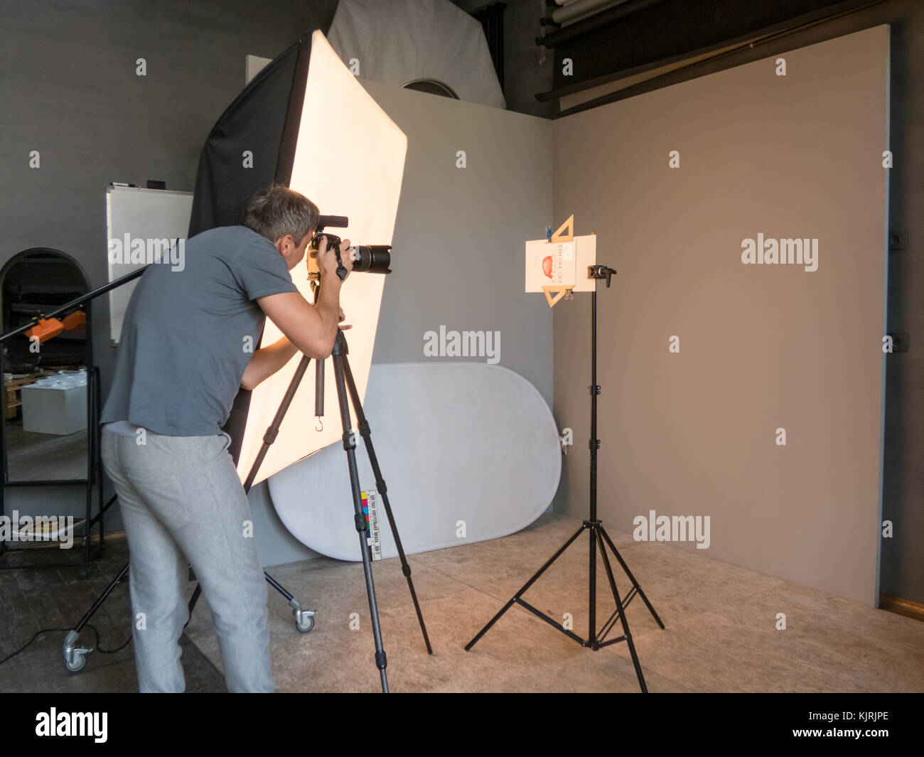 a young man working in the photo studio. unintended photography - Stock Image