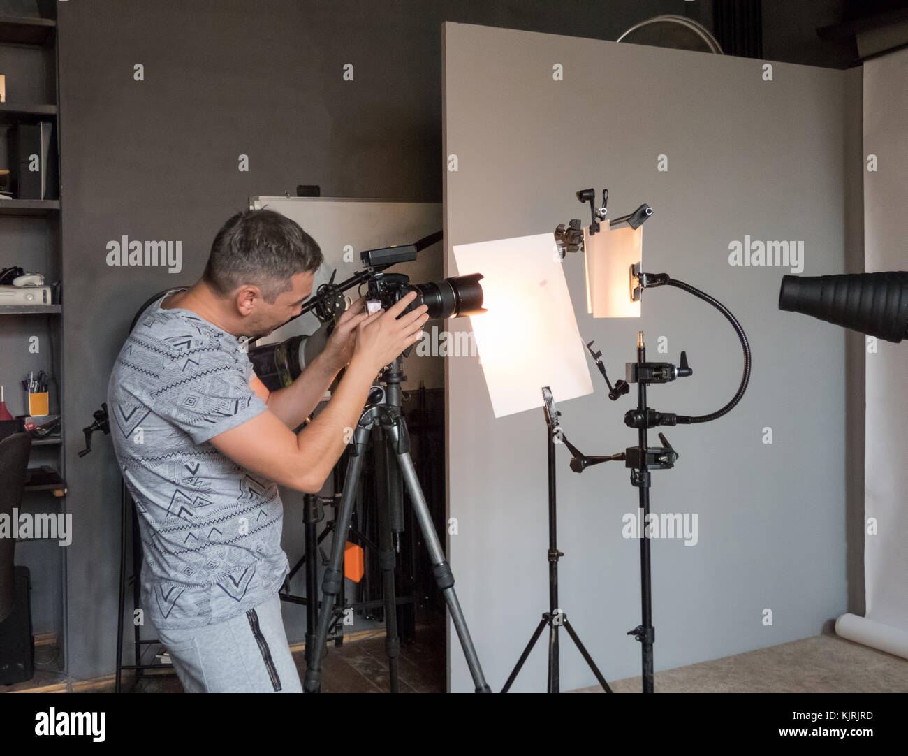 a young photographer work in photo studio. unintended photography Stock Photo