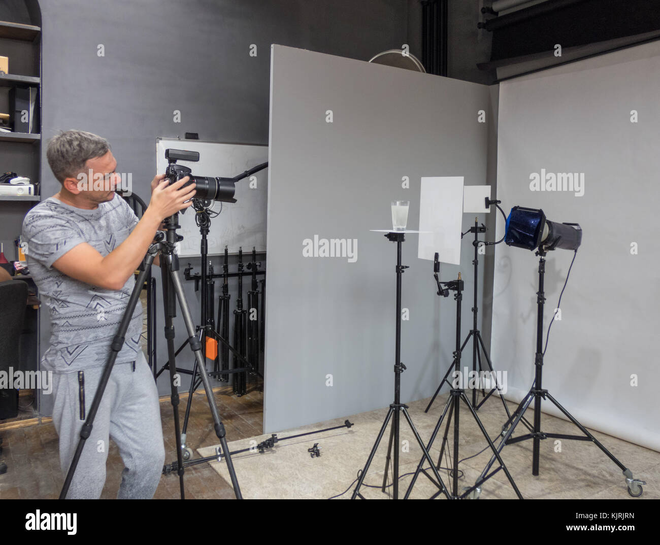 the photographer in the photo studio performs the order for shooting. unintended photography - Stock Image
